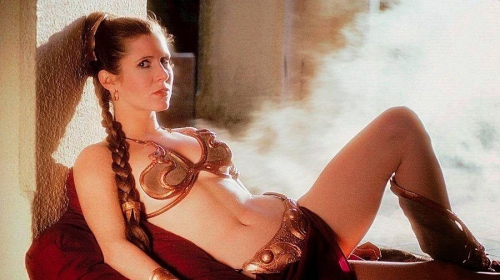 carrie-fisher-posing-seductively-in-a-bikini-1442409878.jpg